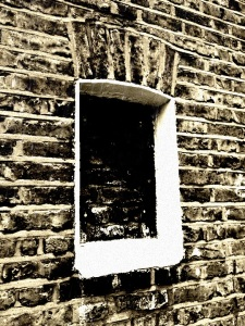 Bricked-up Victorian window in Peckham Rye that looks like a closed eye